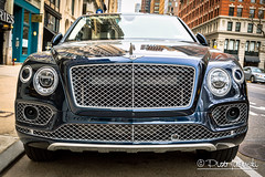 Bentley Bentayga (Karlgoro1) Tags: sony alpha a7r ii mirrorless digital camera ilce7rm2 carl zeiss variosonnar t 3570 mm f 34 cy lens contax new york city street windows window lines reflections geometric structure road car vehicle windshield front light lights building bentley bentayga