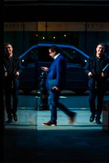 The blues.    #graphic #shadow #gallery_legit #streetportrait #blue #suit #menstyle #capturestreet #urban #silhouette #friendsinperson #Flickr_street #streetbwcolor #art #street_photography #nikon #everybodystreet #reflection #agameoftones #artofphotograp