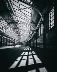 Getaway (raymond_carruthers) Tags: wemyssbay curves leadinglines mono blackandwhitephotography categoryalisted shadows blackwhite bw scotland abellio jamesmiller railwaystation station lines architecture inverclyde steel scottish scotrail glass