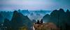 Yangshou, China (Damien Manspeaker) Tags: yangshou china leica m8 voigtlander 28mm mountain hike hiking travel adventure expat expats m camping explore cinema scope movie crop fog hills wander lust wanderlust