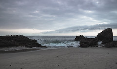 Ephemeral (Gavin Minera) Tags: nature landscape water ocean rocks land sky clouds dark moody bright sunset sand beach shore