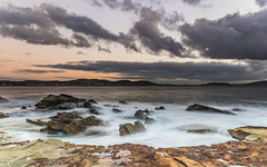 Rocky Sunrise Seascape with Clouds (Merrillie) Tags: daybreak sunrise cloudy australia terrigal nsw rocky sea nature newsouthwales rocks earlymorning morning landscape terrigalhaven ocean centralcoast waterscape clouds coastal waves outdoors seascape dawn coast water sky
