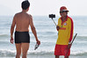 Look who's smiling now (Roving I) Tags: leisure lifestyle lifeguards uniforms goggles whistles redflags sand sea selfiesticks surf smartphones smiles photography service tourism tourists danang vacations vietnam holidays horizon