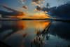 Dark and light (Tati@) Tags: saline stagno molentargius tramonto luce oscurità acqua riflessi colori reflection light dark sunset nature water clouds