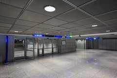 Airport (7687) (Stefan Beckhusen) Tags: building architecture indoor airport travel tourism lights night clean structure lighting airportterminal indoors reflection space metal column modern symmetry glassitems escalator city hall town pillar platform hanover hannoverairport blue light