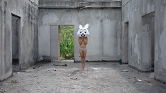 the hunt is on (@_polod_) Tags: hunt rabbit woman fine art conceptual mascot abandoned place hotel mask asian concrete empty urbex nurbex centered fun