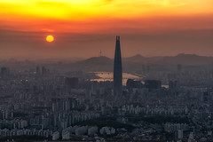 Sunset over dusty air in Seoul (Aaron_Choi) Tags: airquality architecturaldetail architecture asia asian beautiful building buildings capital city cityview cityscape destination district dusty finedust gangnam hanriver haze hazy korea korean landmark lotte lottetower mountain namhansanseong namhansanseongfortress namsan namsantower polluted pollution river seoul sky skyscraper skyscrapers sunset tourism tower travel urban urbanlandscape vast view viewpoint