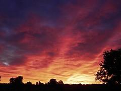 Burning Red (clarkcg photography) Tags: sunset evening light red burningred skyfire fire orange burntorange clouds perspective lightrays lightshades spectrum