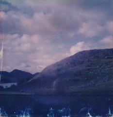 (mari-ann curtis) Tags: sx70 polaroid film polaroidoriginals polaroidweek roidweek landscape norway countryside farm sheep hills mountain lake clouds sky blue purple pink sunshine light shadows rocks impossibleproject travel roadtrip trees summer