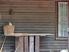 Table On The Front Porch. (dccradio) Tags: whiteoak nc northcarolina bladencounty outside outdoors harmonyhall harmonyhallplantation park museum history historic historical livinghistory cabin house building architecture old antique vintage classic table window basket chicken wood wooden