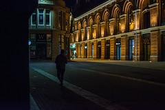 Stalker (C. E. Kingsley-Jones) Tags: nikon 35mm stalker urban people night orange blue contrast shadow lincoln city cornhill person facade building street
