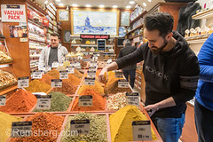 Male merchant uses paint brush to tidy up excess spices off of container in his spice shop at Istanbul Spice bazaar in Turkey (Remsberg Photos) Tags: bazaar market souk spice istanbul turkey egyptianbazaar commerce business retail shopping exchange commodities vendor adult male merchant forsale marketplace indoor choice storefront standing food freshness products eminonuquarter fatihdistrict spices flavor middleeast consumerism economy