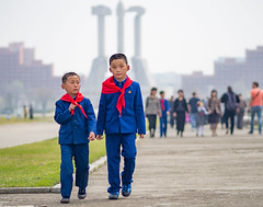 Kids walking in front of the monument of the Party Founding, DPRK (TeunJanssen) Tags: workersparty korea kids dof 75mm f18 northkorea dprk ypt youngpioneertours walking monument pyongyang asia communist founding symbol travel worldtravel traveling backpacking worldtrip olympus omd omdem10