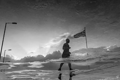 Keep running (tzevang.com) Tags: flag bw greece running shillouete reflection athens fine art