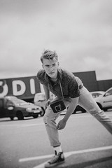 Stand... (dark.indigo) Tags: people portrait popular pretty posing portait pose street 35mm guy male model blackandwhite mono monochrome dof depthoffield retro vintage allstar converse fashion