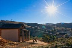 Madagascar - children playing (NettyA) Tags: 2017 africa madagascar rn7 childrenplaying houses sunburst throughbuswindow travel