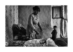 Newborn (Paphylo) Tags: leicaq baby reallife grain rural indoor countryside southwest monochrome dark blackandwhite people ukraine village countrylife document newborn room grand mother