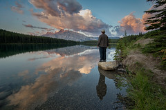 Standing Around Two Jack Lake (`James Wheeler) Tags: banff alberta canada lake water sky mountain nature river reflection cloud landscape outdoors outdoor person man wilderness pond standing travel mountainrange sunset sunrise tourism relaxing contemplating natural hill dramatic amazing life
