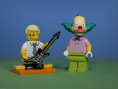 Krusty likes the Birthday Boy's new guitar that his parents bought for him (N.the.Kudzu) Tags: tabletop lego minifigures birthdayboy guitar krusty clown primelens canondslr canon50mmf18 flash lightroom