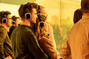 Silent Concert (yannha) Tags: canon85mm18 people couple man woman audience concert silent headphones glass tinted yellow yourrainbowpanorama olafureliasson