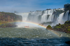 Out of the mist....under the rainbow (RichHaig) Tags: water rainbow nikonafsnikkor2412014ged waterfalls richhaig mist rioiguacu sky boat iguacu river nikond800 rocks