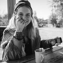 Teddy (BurlapZack) Tags: olympusomdem5markii olympusmzuiko17mmf18 vscofilm pack07 dallastx oakclifftx brunch portrait cute cutie babe coffee breakfast candid laugh smile bw mono monochrome bokeh dof beanie fringe fringejacket vintage style mug table tenbellstavern bar pub food shawl songstress seamstress freckles conversation chat