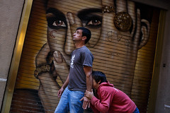 Barcelona (jaumescar) Tags: barcelona catalunya spain urban art street photo eyes man father kid hiding graffiti color funny face pic