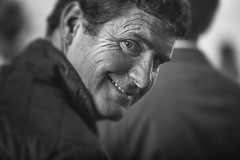 Caught on the turn (Frank Fullard) Tags: frankfullard fullard caught turn eyecontact eye smile monochrome blackandwhite candid street portrait face