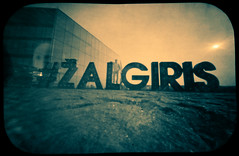 Žalgiris, my Team (batuda) Tags: wppd 2018 pinhole day obscura stenope lochkamera analog analogue tin vintage candy 4x6 mediumformat paper kodak polymax d76 wide wideangle lowangle color colour landscape cityscape portrait city architecture building human silhouette text letters ground sky sun žalgiris zalgiris basketball club team žalgirio arena nemuno sala kaunas lithuania lietuva neodymium