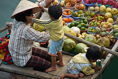 Fruits on boat (TravelKim) Tags: travel voyage photography boat fruits vietnam baiedalong aisa asie photographie childrens family