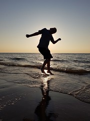 Jump (Dannis van der Heiden) Tags: dans sundown sea northsea jump sun netherlands ouddorp beach fun samsungs8 child silhouette water waves dawn noordzee surf
