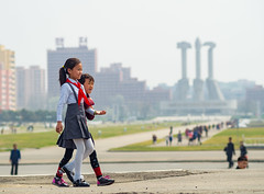 Kids walking in front of the monument of the Party Founding, DPRK (TeunJanssen) Tags: dprk monument kids communist northkorea asia ypt youngpioneertours 75mm dof olympus omd omdem10 korea workersparty symbol travel traveling worldtravel worldtrip backpacking pyongyang