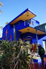 Jardin Majorelle, Marrakech, Morroco (mattk1979) Tags: marrakech morroco arab northafrica sun outdoors sky clouds city buildings old historic jardinmajorelle garden jacquesmajorelle botanical blue yellow house modern