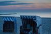 DSC05926 (Tintenfischkleber) Tags: sigma30mmf14dcdn balticsea beachchair sunset dawn blue orange pink ostsee groynes beach sea