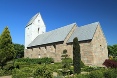 The village Church of Velling (BicycleTripPist) Tags: stone kirke church cemetery shrubs clock rural