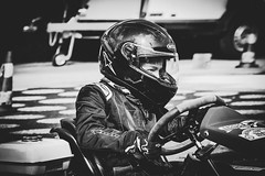 Fast and Furious (Herr Nergal) Tags: fz1000 lumix panasonic race rennen kart speed gokart saarland black white bw sw monochrome people person street photography sport motor bokeh unscharf blurry action