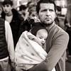 Embrace (Tom Levold (www.levold.de/photosphere)) Tags: cologne fuji funfair kirmes köln xt2 xf56mmf12 bw porträt portrait people sw candid vater baby father