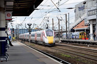 DSC_7161 Doncaster Railway Station South Yorkshire Virgin East Coast Japanese Hitachi Azuma Train passing the EMPTY factory where Sir Nigel Gresley used to build the finest BRITISH Steam Trains in the world. Virgin Trains should be ashamed at buying Forei