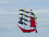 Sailing a Kite (Steve Taylor (Photography)) Tags: ship boat kite rainbow newzealand nz southisland canterbury christchurch newbrighton sky cloud sails mast string rudder kiteday