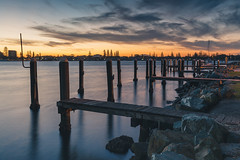Sunset over Cape Hawke Harbour (dean.white) Tags: australia au newsouthwales nsw greatlakes greatlakesnsw coolongolookriver river wallislake forster forstermarina wharf jetty water clouds johnhollandpark sunset longexposure canoneos6d canonef1635mmf4lisusm leefilters nd06softgrad