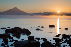 Sunrise on Llanquihue Lake (Waldemar*) Tags: latinamerica southamerica chile loslagos puertovaras osorno volcano volcanic llanquihuelake nature landscape water sunrise fog mist rocks stones mountain longexposure leefilters