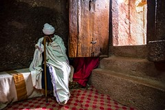 Orthodox Priest (Rod Waddington) Tags: africa african afrique afrika äthiopien ethiopia ethiopian ethnic etiopia ethnicity ethiopie etiopian tigray lalibela rockhewnchurch rock church christianity orthodox priest staff steps door shamma indoor unesco