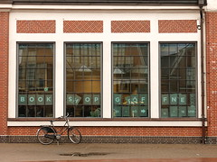 book shop and bicycle (vertblu) Tags: bookshop bicycle windows signs transomwindows muntinwindows wall brickwork brickarchitecture building brickbuilding redbrickbuilding architecture geometric geometrical geometry reflection reflections reflectedbuilding vertblu museumshop horizontals verticals mirroring mirrored