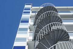 Metal spiral stairway (Jan van der Wolf) Tags: sta trap staircase architecture architectuur metal spiralstaircase facade poeldijk blue blauw flat apartmentbuilding 176201