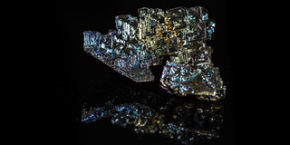 Bismuth on black with reflections