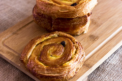 Twisted bun with raisins from puff pastry on sackcloth (yannamelissa) Tags: isolated pastry background white danish raisin texture food closeup fresh brown macro frame sweet golden delicious tasty swirl snack gourmet dessert breakfast sugar spiral bread desert fat milk french wheat baked bakery sticky crust flour twist honey dough bun butter cinnamon wooden yellow hot group sackcloth