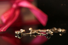 All that glitters isn't gold... (eleni m) Tags: present lovely bracelet macro silver reflection box indoor pink bow bokeh dof glitter glitters ribbon