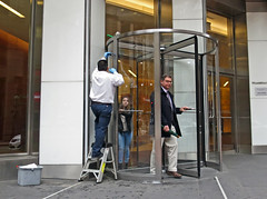 BostonSpinPastCleaner (fotosqrrl) Tags: boston massachusetts streetphotography urban statestreet congressstreet revolvingdoor cleaning entrance