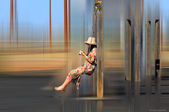 The tourist on the swing - La turista sobre el columpio (ricardocarmonafdez) Tags: streetphotography city columpio swing people effect edition processing movement sunlight color imagination concept 60d 1785isusm canon