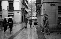 The Rain.... (Gabo Barreto) Tags: sansebastian donostia paisvasco basquecountry spain rain raining umbrellas street walking film blackandwhite olympusstylusepic olympus ilford xp2 analoguephotography monochrome filmisnotdead corner
